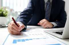 Professional manager working with finance document. Accountant signing finance report. Analysis working budget accounting startup economy man concept royalty free stock images