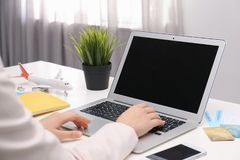 Professional manager working at laptop in travel agency. Closeup royalty free stock photography