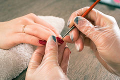 Professional manicure beautician stock photography