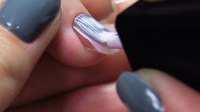 Professional manicure procedure in beauty salon slowmotion. stock footage