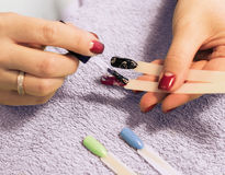Professional manicure procedure in beauty salon. Woman hands close up Royalty Free Stock Photos