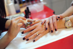 Professional Manicure. A shot from a photo session taken in a Beauty Salon Royalty Free Stock Images