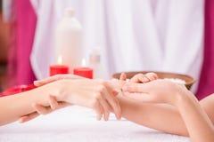 Professional manicurist making manicure Stock Photo