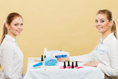 Professional manicurist painting woman nails. Stock Photo