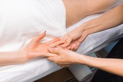 Professional massage of hands royalty free stock photography