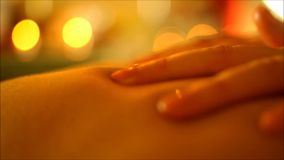 Professional massage makes the massage hands and oil stock video