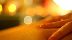 Professional massage makes the massage hands and oil stock video footage