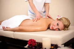 Professional masseur doing massage of female back in the beauty Royalty Free Stock Photo