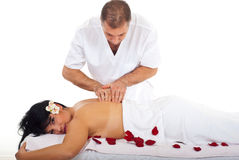 Professional masseur giving woman massage royalty free stock images