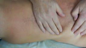 Professional masseur makes massage for old man
