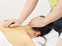 Professional masseur and a woman customer Stock Image