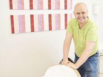 Professional masseur and a woman customer Stock Photography