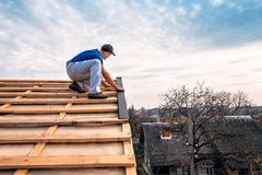 Professional master makes new roof royalty free stock photo