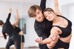 Professional masterful dancers looking at the hands stock photo