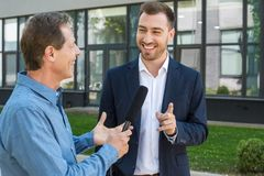 professional mature journalist interviewing public royalty free stock photo