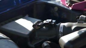 Professional mechanic sets the oxygen sensor stock video footage
