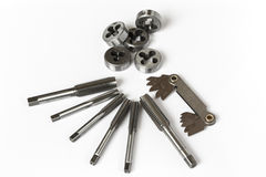 Professional mechanical hand tool set . Tap and die nuts for metal work. Stock Photos
