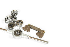 Professional mechanical hand tool set . Tap and die nuts for metal work. Royalty Free Stock Photography