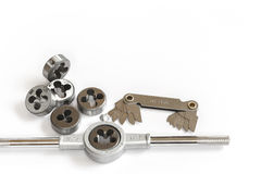 Professional mechanical hand tool set . Tap and die nuts for metal work. Royalty Free Stock Photos