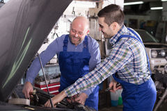 Professional mechanics repairing car Royalty Free Stock Photo