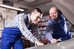 Professional mechanics repairing car Royalty Free Stock Photography