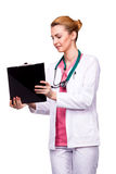 Professional medic showing the clipboard Royalty Free Stock Image