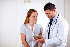Professional medical doctor with a patient Stock Photography