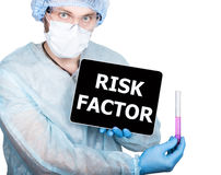 Professional medical doctor showing tablet pc and risk factor sign a display, isolated on white Stock Photo