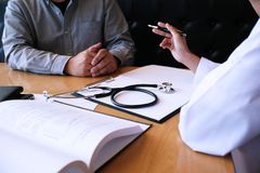 Professional medical doctor in white uniform gown coat interview stock photography