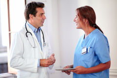 Professional medical group standing and speaking Stock Photo