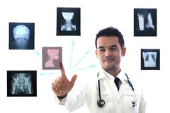 Professional medical looking and consult examining a patient`s x-Ray film. Royalty Free Stock Photos
