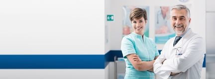 Medical staff posing at the hospital stock photo