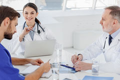 Professional medical team working together at hospital Stock Images