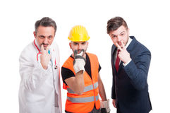 Professional men doing look into my eyes gesture Stock Photo