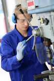 Professional metalworker making holes Royalty Free Stock Photos