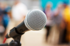 Professional microphone. Professional vocal microphone against people Royalty Free Stock Image