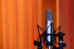 Professional Microphone, Condenser Mic On The Stage , Closeup, Copy Space. Professional condenser microphone closeup on the stand in concert hall with copy royalty free stock photo