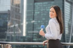Pretty journalist on business center background Royalty Free Stock Photos
