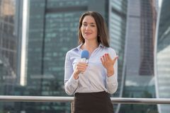 Pretty journalist on business center background Royalty Free Stock Image