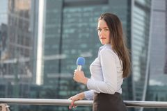 Pretty journalist on business center background Royalty Free Stock Photo