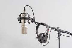 Professional  microphone with headphones on a stand. Stock Photos