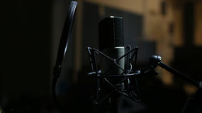 Professional Microphone in Recording Studio. Professional Studio Background with space for text Royalty Free Stock Photos