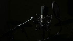 Professional Microphone in Studio. Professional Microphone in Recording Studio, Professional Studio Background with space for text Royalty Free Stock Images
