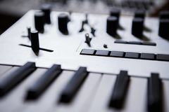 Professional midi keyboard for electronic music composer. Professional electronic midi keyboard with black and white piano keys.Audio equipment for music royalty free stock images