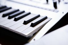 Professional midi keyboard for electronic music composer. Synthesizer key board in close up.Audio equipment for music production.Sound recording studio device royalty free stock photo