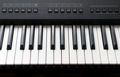 Professional midi keyboard synthesizer. Royalty Free Stock Images