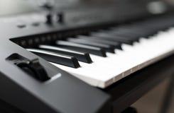 Professional midi keyboard synthesizer. Royalty Free Stock Photo