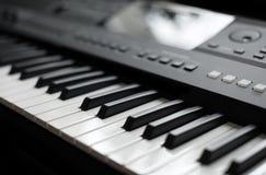 Professional midi keyboard synthesizer. Royalty Free Stock Photos