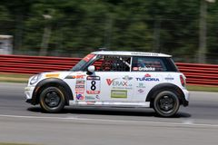 Professional MINI Cooper race car on the course Stock Photo