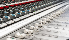 Professional Mixer for audio mixing. Close up of a professional audio mixer in a recording studio Royalty Free Stock Image